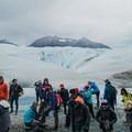 Putting on the crampons.- Perito Moreno Glacier Hike