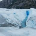 The water pours into holes in the glacier's surface.- Perito Moreno Glacier Hike