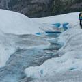 Walking along a glacial stream.- Perito Moreno Glacier Hike