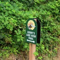 A solitary sign marking the roadside trailhead.- Loony's Lakeview Trail