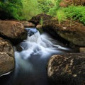 Mill Creek, where Loon Lake drains, pours dramatically over several cascades.- Loon Lake