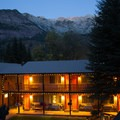 A warm evening glow welcomes visitors to Box Canyon Lodge and Hot Springs.- Box Canyon Lodge + Hot Springs