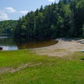 Shoreline for launching watercraft.- Paradox Lake Campground