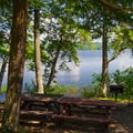 Picnic tables and grills are available at the lakeside.- Paradox Lake Campground