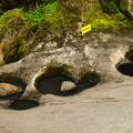 Potholes are created when a rock or pebbles are caught in a small opening and then moved around by water. This motion causes friction, which in turn wears a hole in the rock.- Natural Stone Bridge and Caves Park