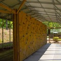 Bouldering wall for climbing.- Natural Stone Bridge and Caves Park