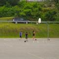 People playing basketball at the park.- Veteran's Memorial Park