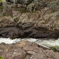 A part of the falls where water has carved a flume.- Northwest Bay Brook Falls