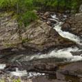 The falls wraps around a tight corner.- Northwest Bay Brook Falls