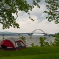 This campsite offers a great view of the Crown Point Bridge.- Crown Point Campground