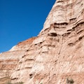 The layered cliffs at the beginning of the trail.- Toadstools Trail through Paria Rimrocks