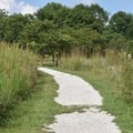 Part of the trail is gravel at George Washington Carver National Monument.- George Washington Carver National Monument