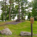 ADA-accessible picnic tables and grills.- Rogers Rock Campground
