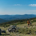 Admiring the extended views above the treeline.- South Arapaho Peak