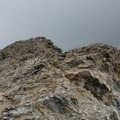 The true summit can be seen only after cresting the summit ridge.- South Arapaho Peak