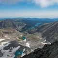 The long string of lakes fed by Arapaho Glacier.- South Arapaho Peak