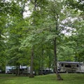 The campground offers multiple spots for RVs and tents. - Cumberland Mountain State Park Campground