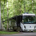 The campsites are spacious and can also host larger RVs.- Cumberland Mountain State Park Campground