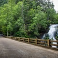 Bald River Falls is one of the few waterfalls in Tennessee that is viewable from the road. - Bald River Falls