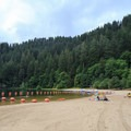 A vast sandy beach with access to the swim area.- Loon Lake Recreation Site