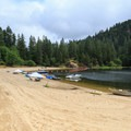 Expansive sandy beach at the Loon Lake Recreation Site.- Loon Lake Recreation Site