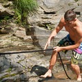 Using the rope to climb out of the swimming hole.- Frenchman's Hole