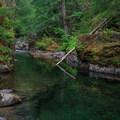 Emerald Pool, a deep and vibrant jewel.- Elk Lake Creek: North Trailhead to Battle Creek