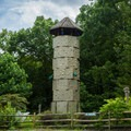 A climbing tower for children at the Meadows.- Chimney Rock State Park