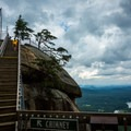 The final flight of stairs to the Chimney.- Chimney Rock State Park