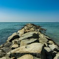 The west jetty of the Kennebunk River.- Gooch's Beach