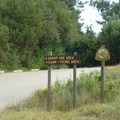 Turn left for the picnic area and trailhead.- Shafer Butte and Mores Mountain Trailhead