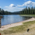 A swimming beach is right at the campground.- Seeley Lake Campground
