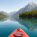 Start early for a better chance of calm, glassy water.- Bowman Lake Paddle