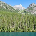 Snowfields and a waterfall high above the lake.- Bowman Lake Paddle