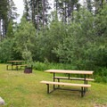 Picnic tables and fire ring at Southview.- Southview Provincial Recreation Area