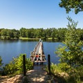 An old bridge crossing Lake Placid.- Chickasaw State Park