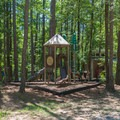 A well-shaded playground near campsites.- Pickwick Landing Campground