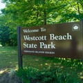 The welcome sign.- Westcott Beach State Park