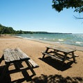 Picnic tables by the beach.- Westcott Beach Campground
