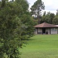 The rental cabins have their own picnic area.- Bill Frederick Park + Campground at Turkey Lake