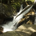 A small cascade above the falls.- Skinny Dip Falls