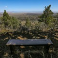 A bench in a rare spot of shade makes for a great spot to take in the views.- Schonchin Butte