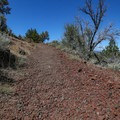 Volcanic rock makes up a bit of the trail surface.- Schonchin Butte
