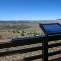 Though the interior of the fire lookout is closed to the public, interpretive signs wrap around the porch walkway of the lookout.- Schonchin Butte