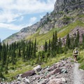 The terrain around Lake Ellen Wilson is wide open and beautiful.- Gunsight Pass Trail
