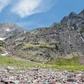 Waterfalls high above Lake Ellen Wilson.- Gunsight Pass Trail