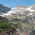 Snowfields remain all year up here.- Gunsight Pass Trail