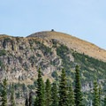 Glimpse of Swiftcurrent Lookout from below on the Loop Trail.- Swiftcurrent Lookout