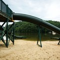 The dual slides go straight into the lake.- Lake Lure Beach