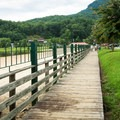 A boardwalk leads around the perimeter of the lake shore to restaurants and shops.- Lake Lure Beach